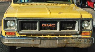 Detail of grille on yellow GMC truck