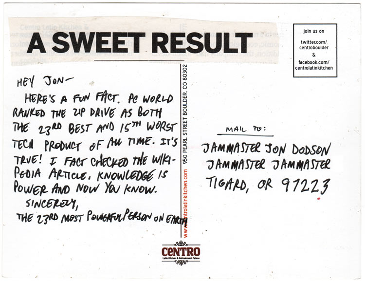 "Reverse side of collage postcard, with postcard text and cut-out headline that says ""A sweet result"""
