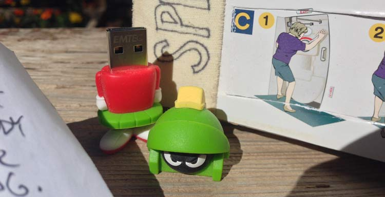 "A ""Marvin the Martian"" USB stick sits between a letter and an advent calendar."